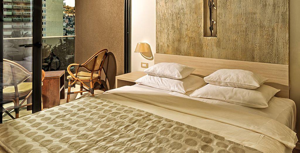 Su habitación Doble con vistas al mar desde el balcón