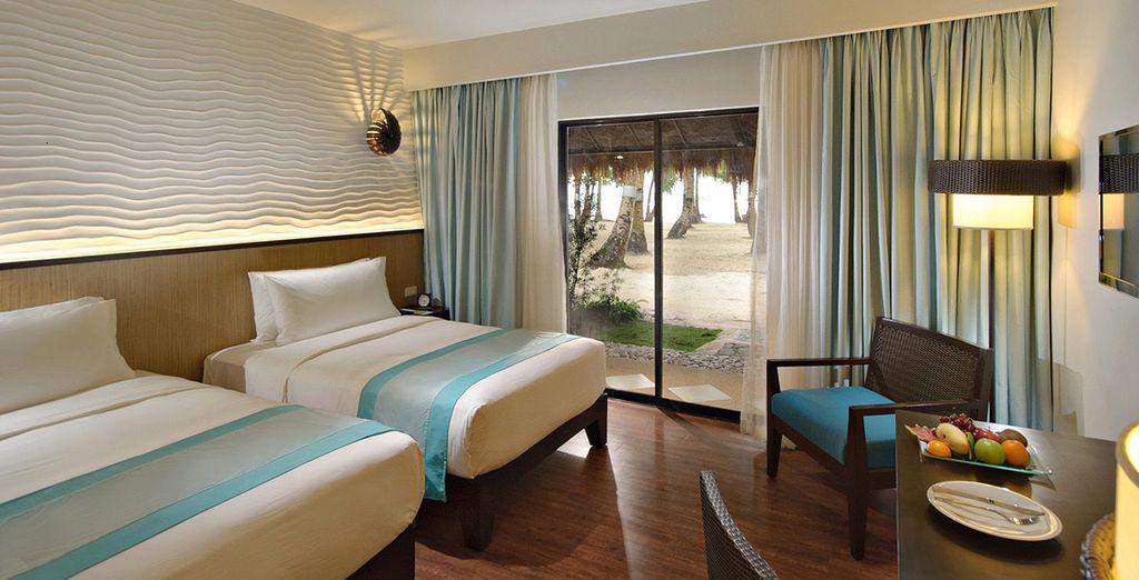 Te alojarás en una elegante habitación Deluxe con Vistas al Mar