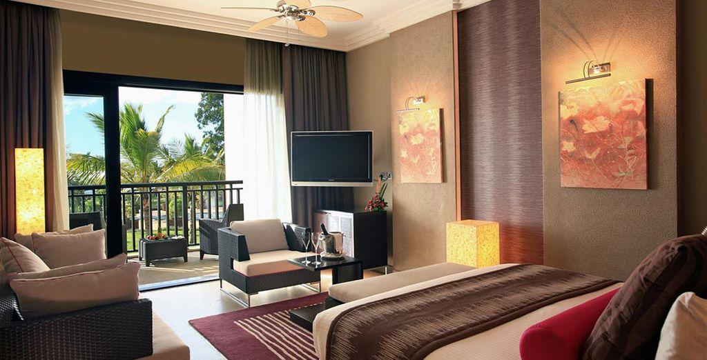 Podrás elegir alojarte en una elegante habitación Deluxe...