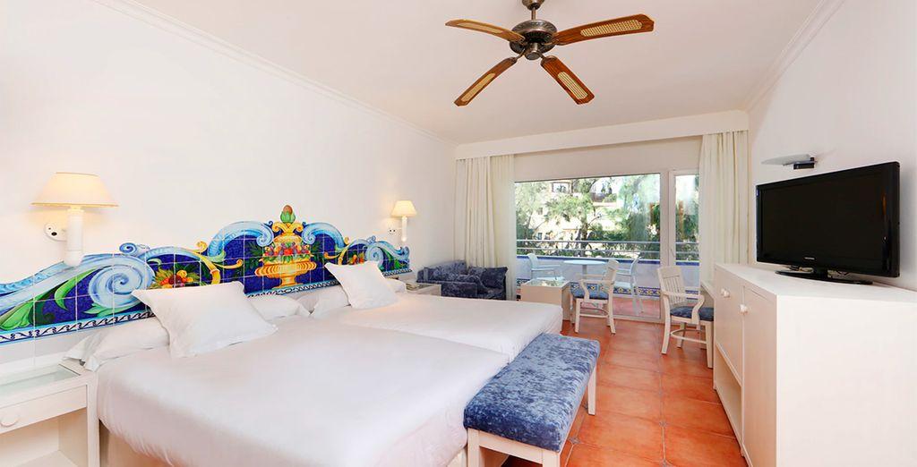 Elige descansar en una amplia y confortable habitación Estándar