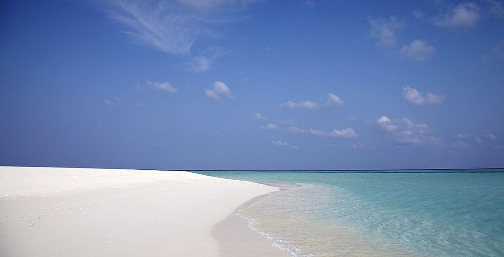 Et foulez le sable blanc d'une île privée