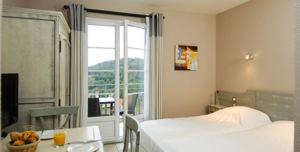 Profitez de l'intimité cosy de votre studio avec balcon