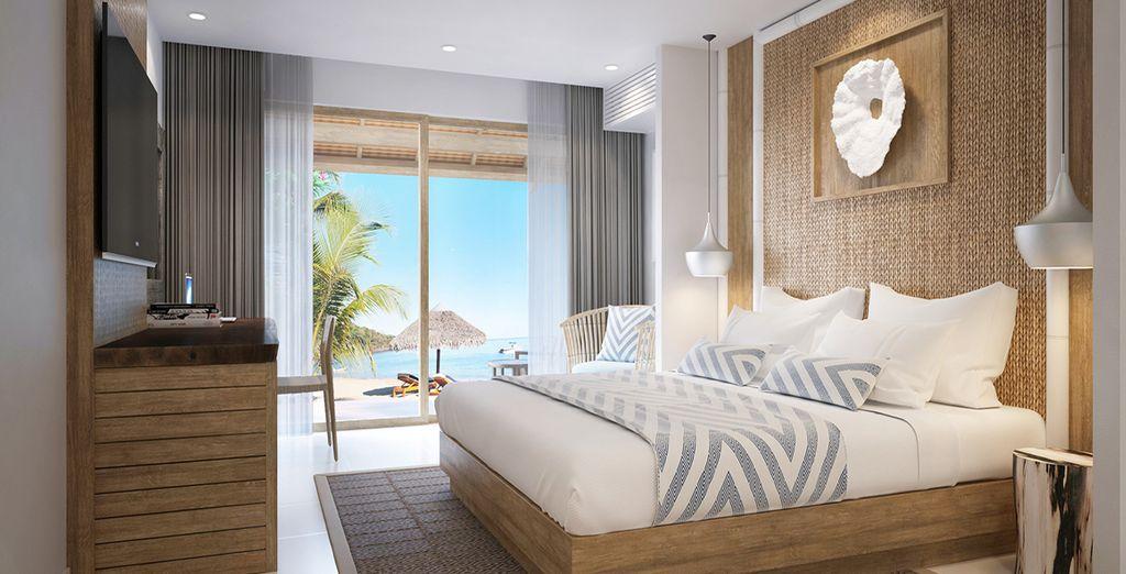 Hôtel 5 étoiles haut de gamme avec chambre double tout confort donnant directement à de belles plages de sable blanc