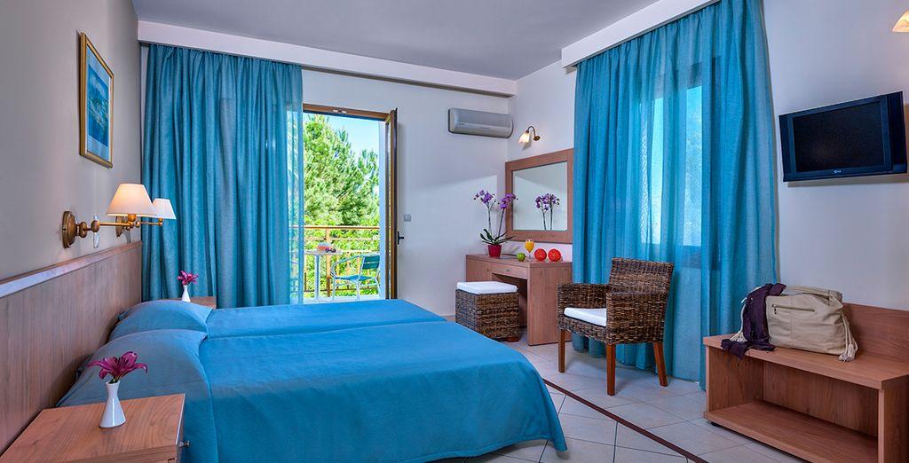 Installez-vous dans le confort de la chambre Standard, dotée d'un balcon