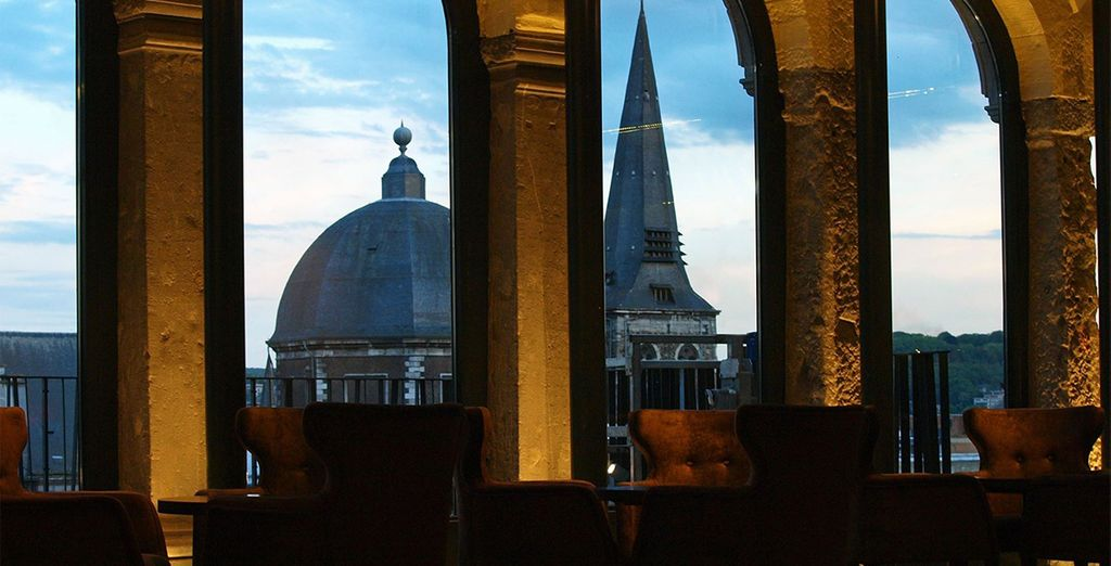 Venture to the lounge bar overlooking the rooftops ...