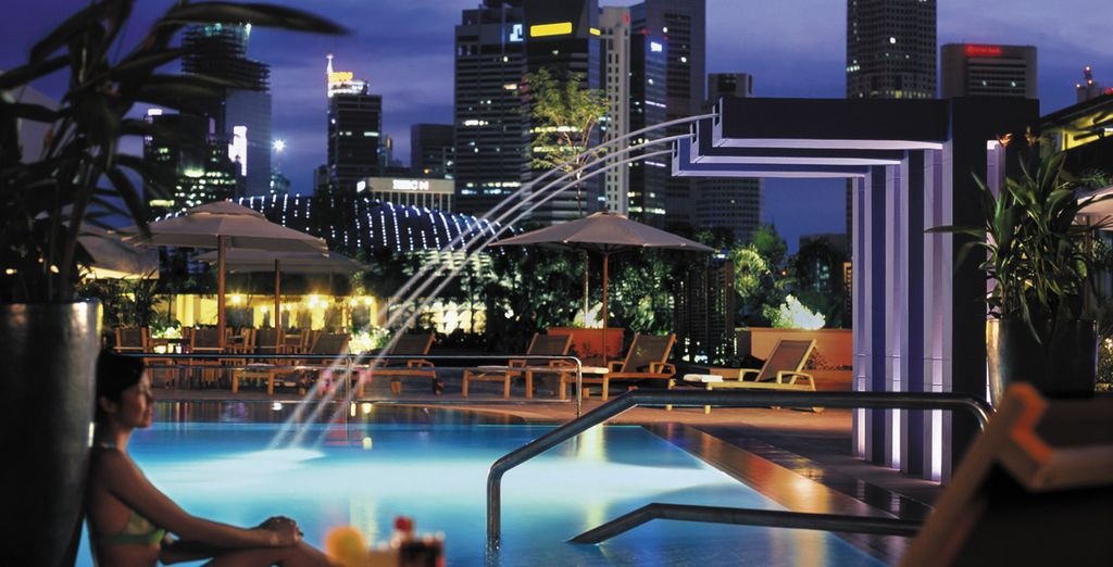 Take in the skyscraper view from the rooftop pool