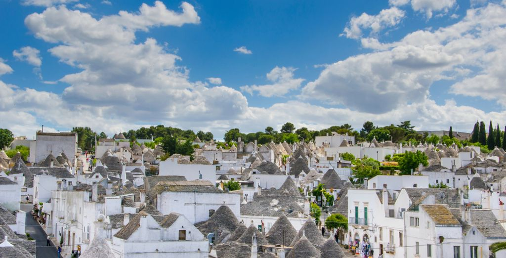 Enter a world of fantasty with a trip to Alberobello to see its prehistoric trulli buildings