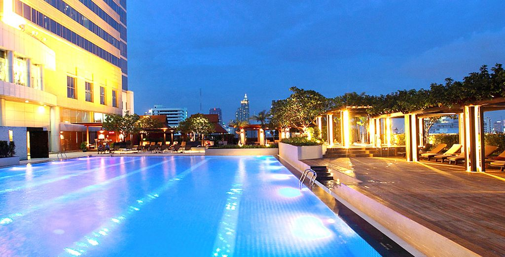The outdoor pool boasts magnificent cityscape views