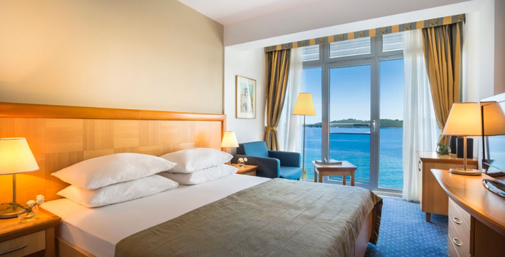 Settle into your Superior Double Room overlooking the sea