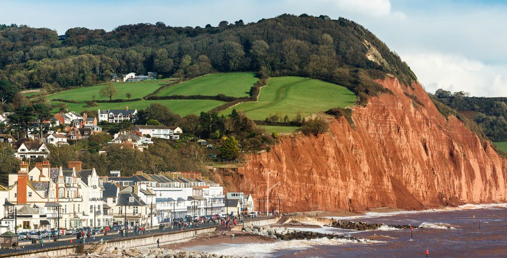 Near The Dramatic Red Cliffs Of Sidmouth A Well Preserved Regency Town
