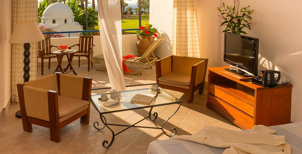 Stay in a spacious Premium Garden & Sea View Room