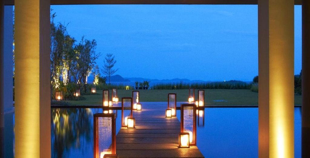 As you relax by the beautifully lit pool