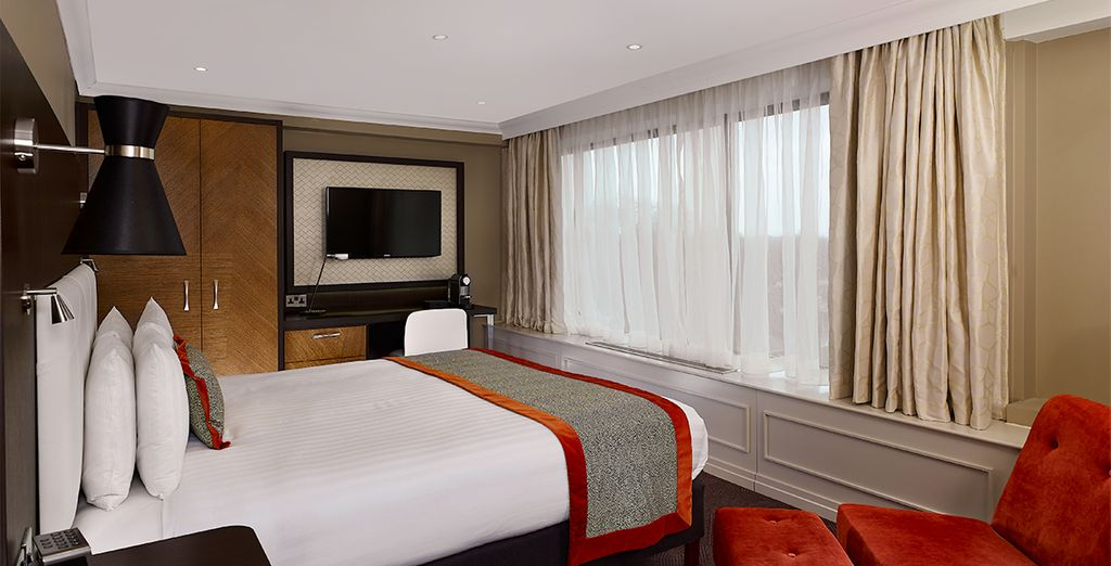 Stay in a plush King Deluxe Room