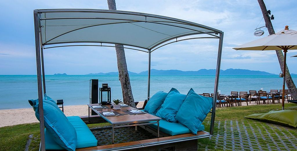 Dine al fresco and admire the lovely clear, blue ocean
