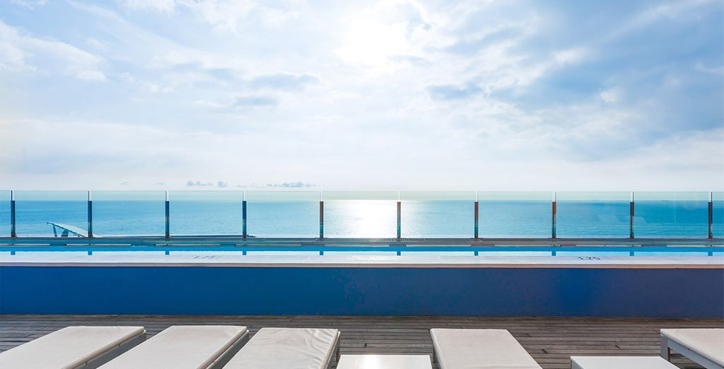 Take in the panoramic sea views from the rooftop pool