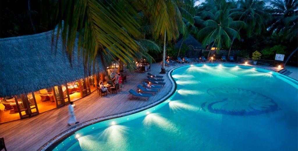 As night falls around the pool