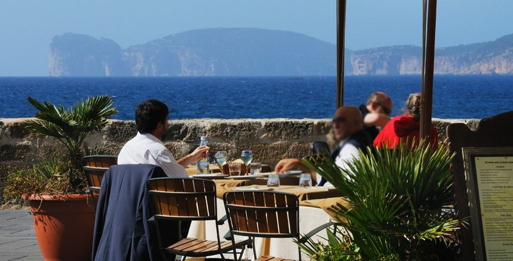Explore the bustling cafes and shops of Alghero