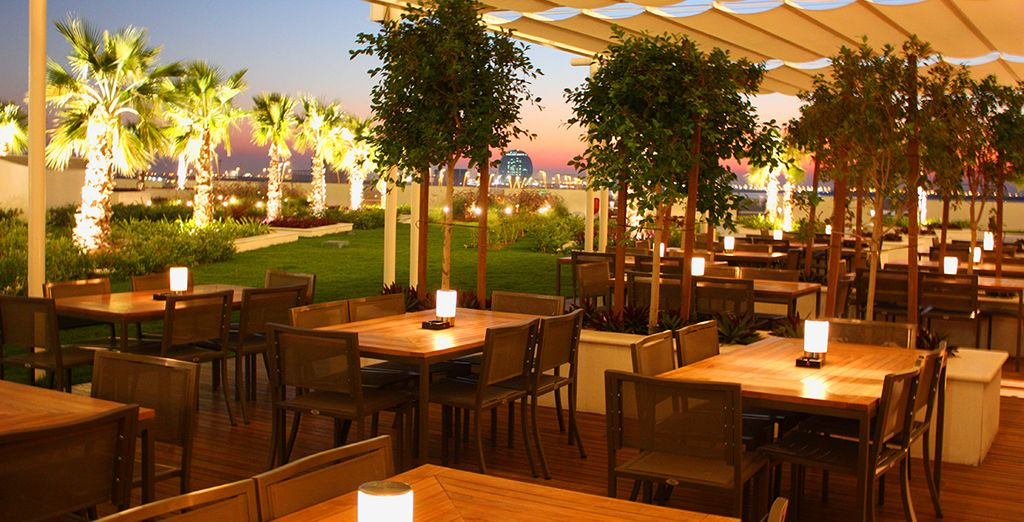 Enjoy a drink on the terrace as you look out over Abu Dhabi...