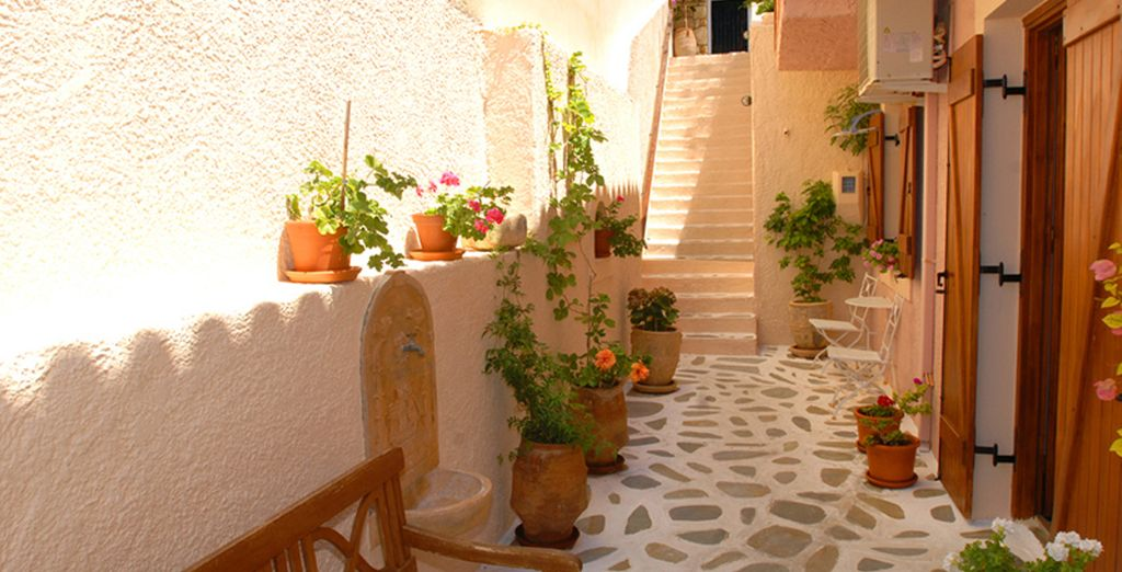 Walk along the flower-lined path to this charming hotel