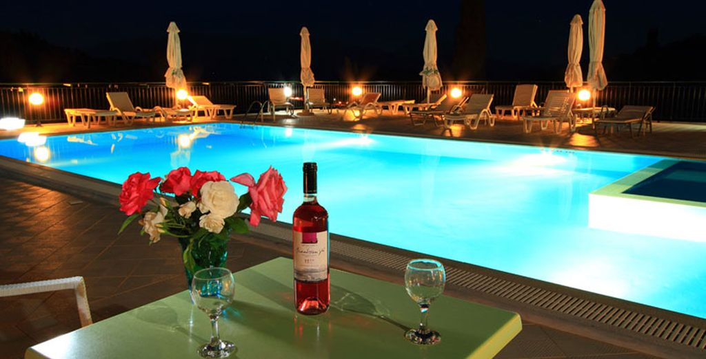 Or enjoy a glass of wine by the hotel pool