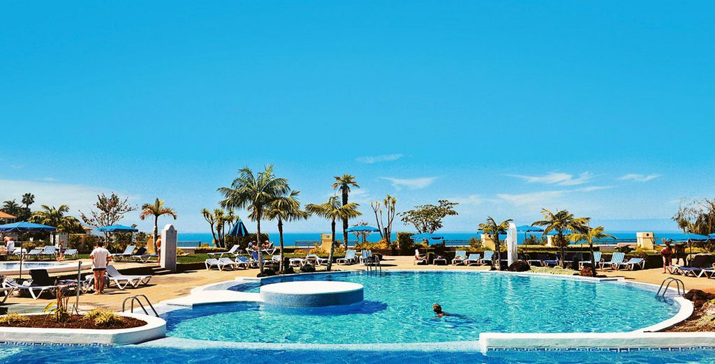 Or by the pool, admiring the sea views