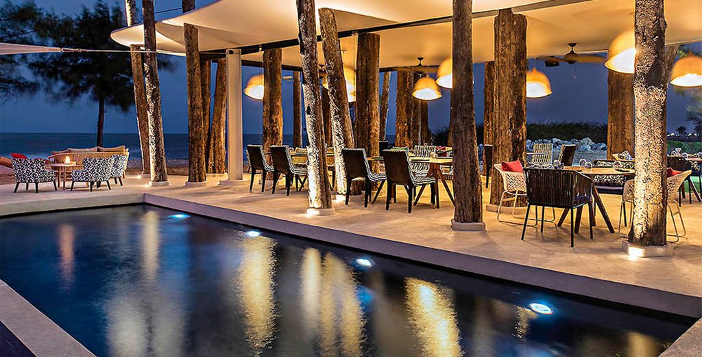 And poolside dining, as night falls