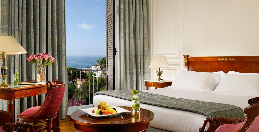 Relax in a comfortable and plush Deluxe Sea View Room