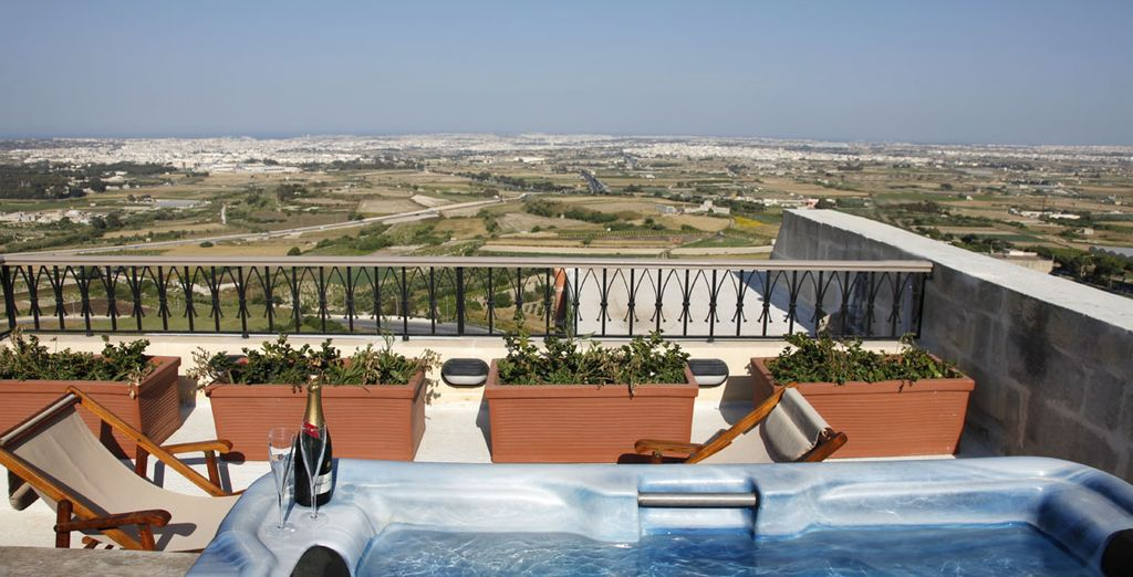 Then head to the rooftop pool (a 5 minute drive from the hotel), which overlooks the ancient medieval city of Mdina