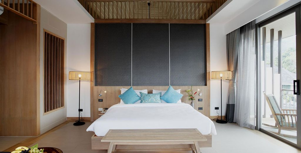 Panoramic Deluxe rooms are set on the top floor of two-storey villas