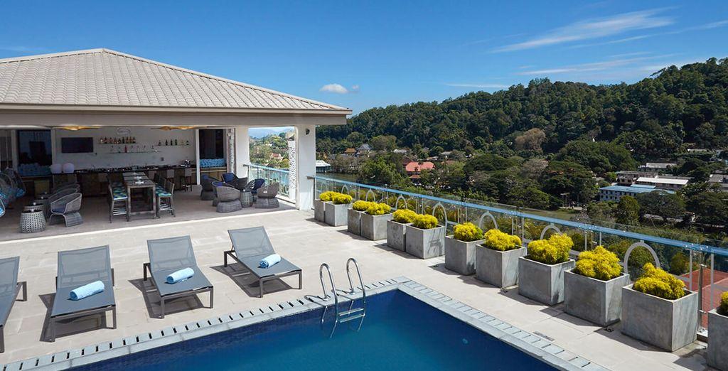 Enjoying its Rooftop Pool & Lounge