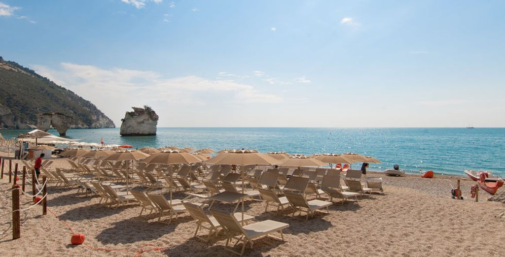 Head down to the Baia Dei Faraglioni's private beach