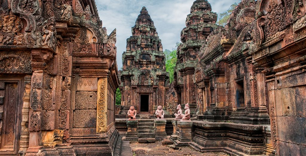 Then immerse yourself in the spiritual site of Banteay Srei - a 10th century Hindu temple dedicated to Shiva
