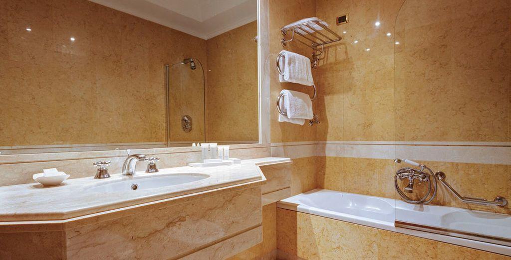With a lovely modern bathroom