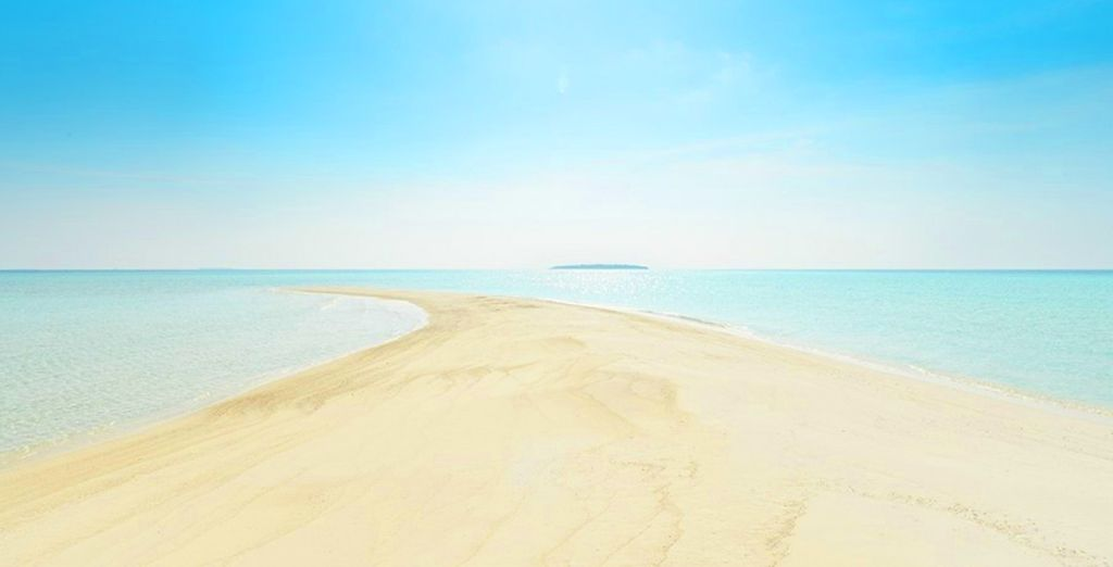 Where white sands and turquoise seas await