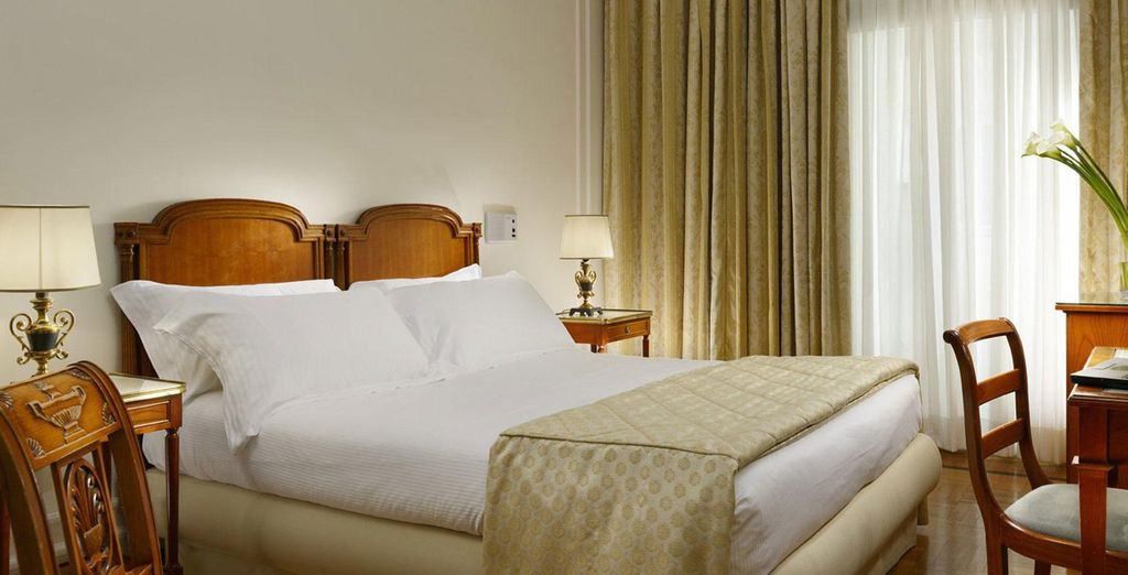 Relax in a comfortable and plush Classic Room