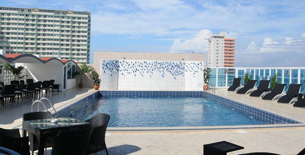 After sightseeing, cool off with a dip in the sparkling rooftop pool