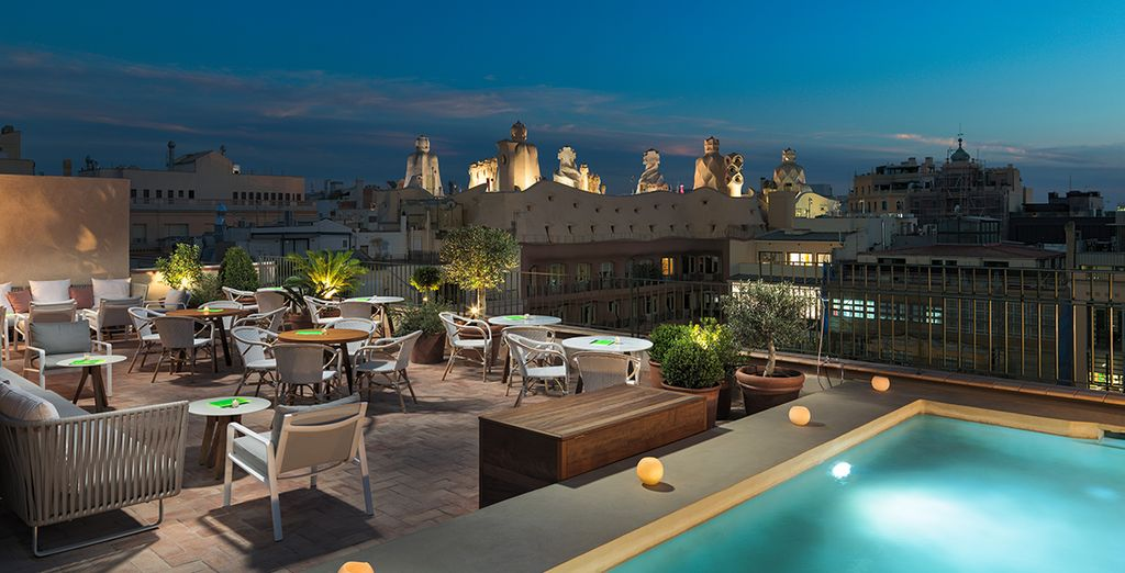 Admire fantastic views from the rooftop as night falls