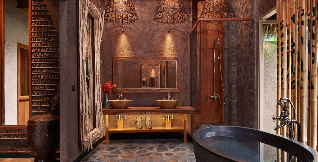 Enjoy your monsoon shower, outside shower and a stand-alone bathtub