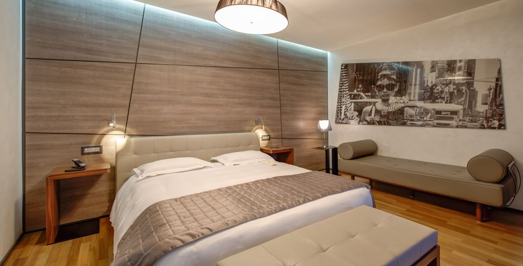 Make your way up to your upgraded room of contemporary design
