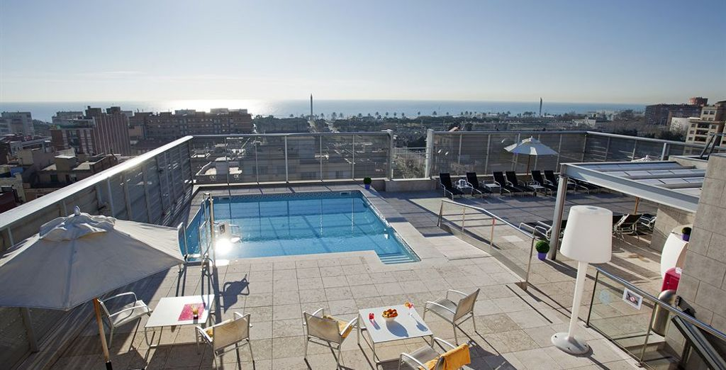 Imagine bathing by this rooftop pool...