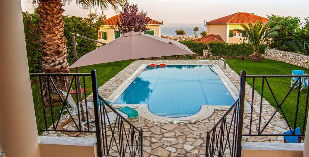 With a private pool and garden