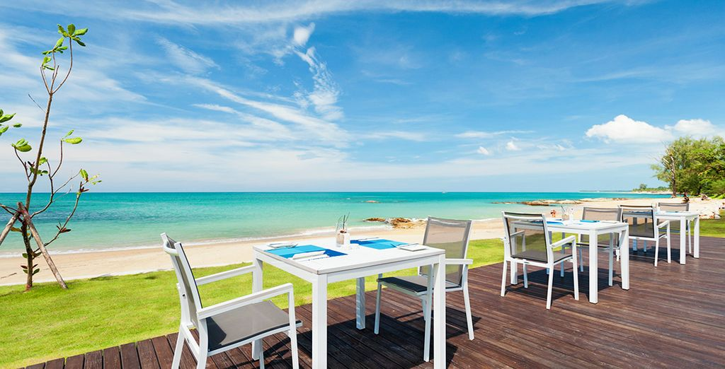 Tuck into delicious with the azure Andaman Sea as your backdrop