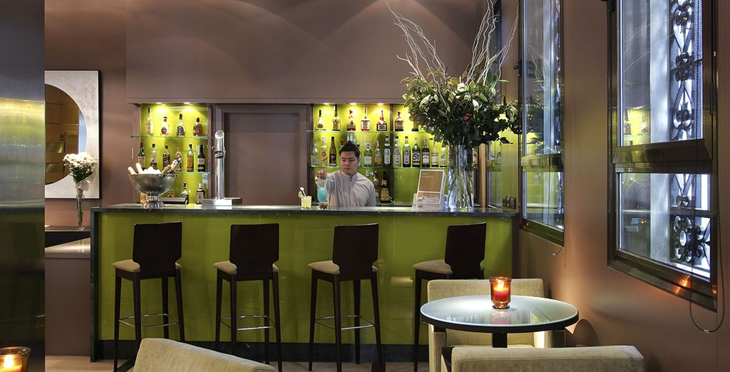 Be treated to a welcome drink in the coolness of the bar