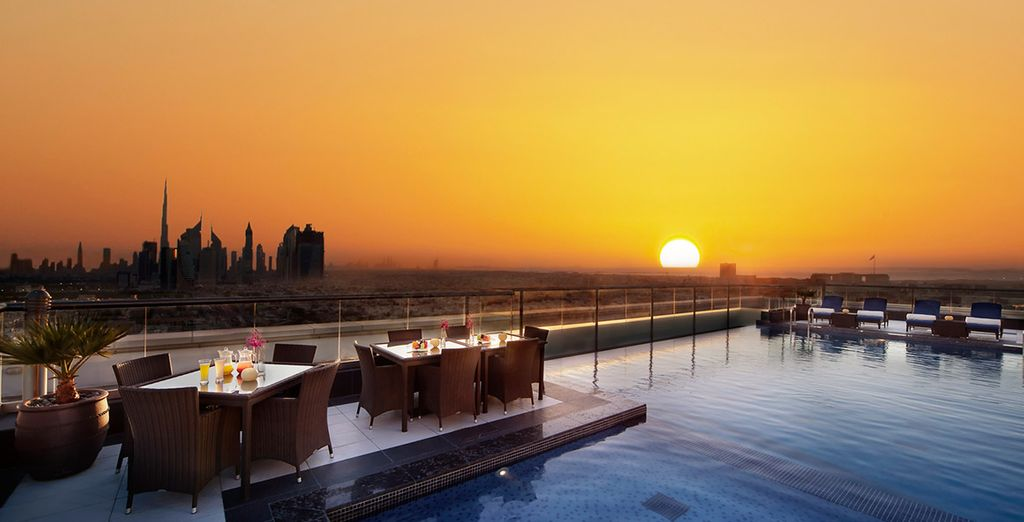 Watch the sunset from the rooftop pool