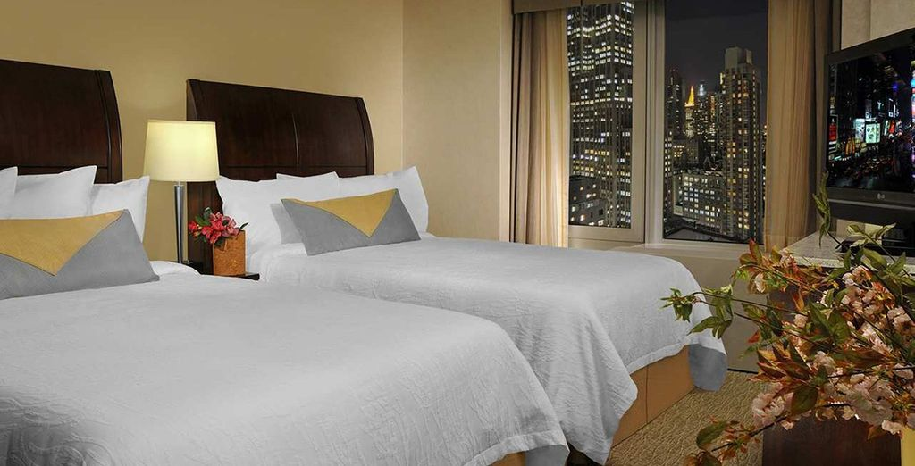 Enjoy a central Midtown stay at a contemporary and stylish Hilton Hotel