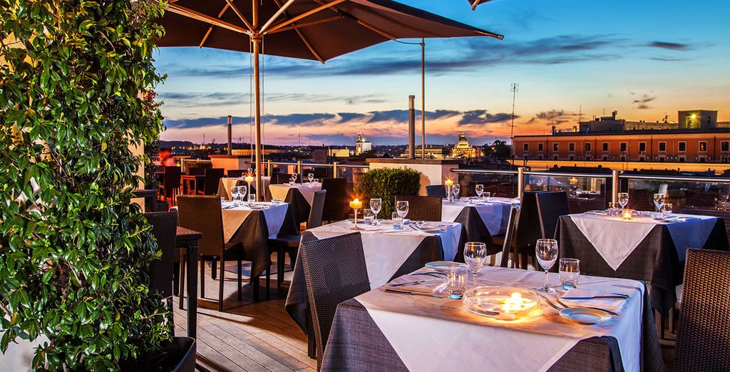 End your day with stunning city views from the rooftop restaurant