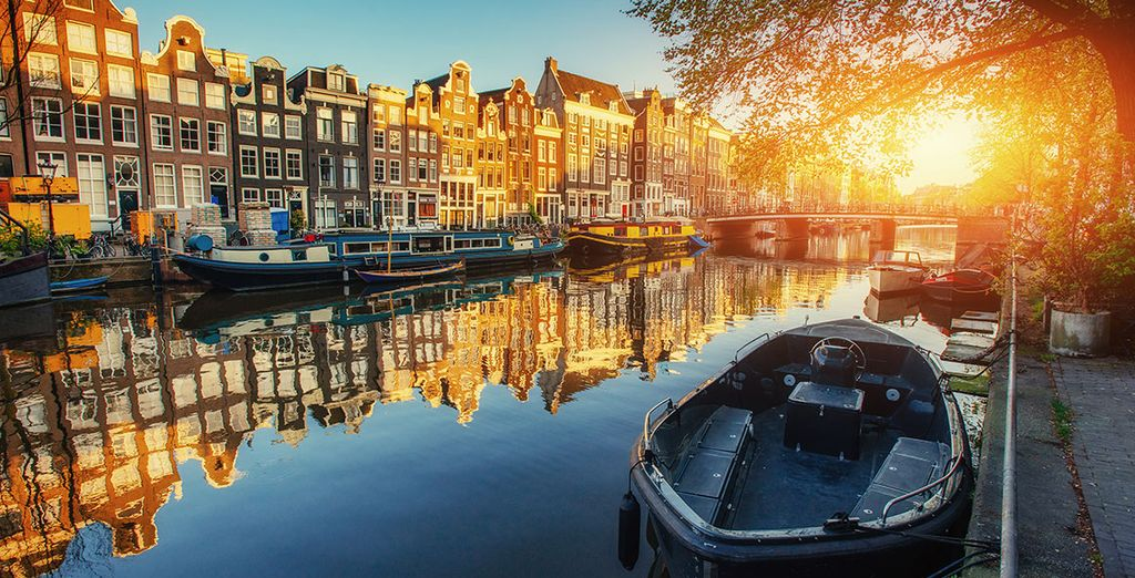 Stroll along the famous canals of Amsterdam