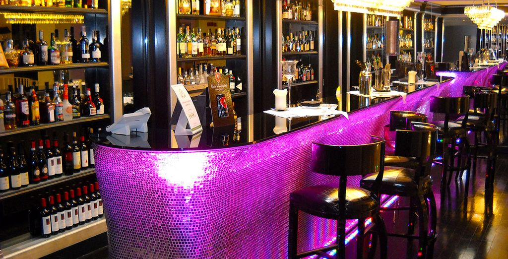 Order your favourite beverages in the stylish bar