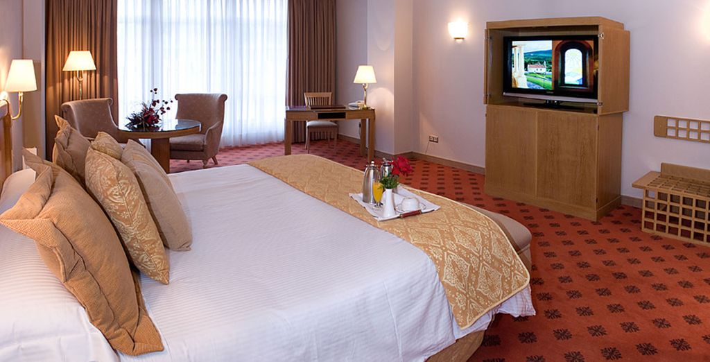 You'll stay in a plush Deluxe Room