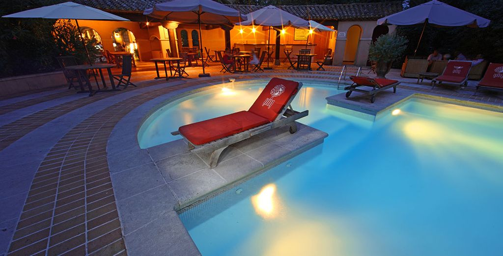 Enjoy a drink by the pool as the evening comes